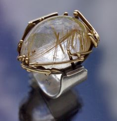 SCULPTURAL  Ring   Silver Gold Rutilated Quartz  H: 3 cm (1.18 in)  Marks: '14 K' & 'Silver'  American, c.1960