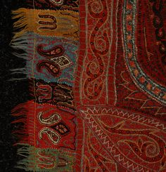 KASHMIRI PAISLEY SHAWL 19th C. Handmade wool paisley having small black center in green, red, orange and blue palette with tabbed border. 66 x 66. (Few minor holes)