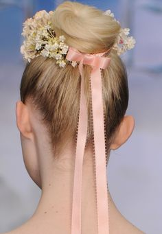 """Elle Fanning (Hair detail) at the private reception as costumes and props from Disney's """"Maleficent"""" in London"""
