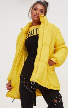 Yellow Ring Pull Longline Puffer JacketGirl stand out in the crowd wearing this hella cute yellow...