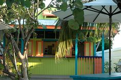 """Blanchards Beach Shack, Meads Bay, Anguilla. Yep, the same Blancards that wrote """"A Trip to the Beach,"""" one of my favorite beach reads. """"Our menu also features all-natural burgers, fresh-cut fries, rum punch, sangria and an extensive list of frozen drinks (mango coladas and frozen mojitos top the list) as well as a carefully chosen selection of beer and wine. Come visit us for lunch, dinner, a sunset drink or a frozen yogurt snack. We all look forward to seeing you on the beach!"""""""