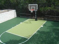 Sport Court! like these colors…not crazy bright ones.  It should blend in the backyard
