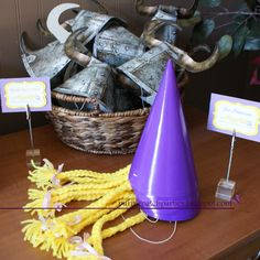 "Ruffians hats come from Hallmark...""How to Train Your Dragon"" theme. Princess hats make with plain purple hats, yellow yarn, & ribbon"