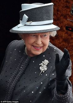 Saying her goodbyes: The Queen waves as she boards the jet bringing her home to London and...