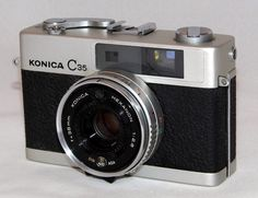 https://flic.kr/p/Vm9SdE | Vintage Konica C35 35mm Rangefinder Camera, Made In Japan, Circa 1935 | Auction Item 105 - To be auctioned by Cledis Estes Auctions II in Medina, Ohio.