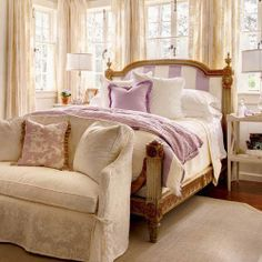 I love the windows in this bedroom....and the adorable setee...and the french bed...