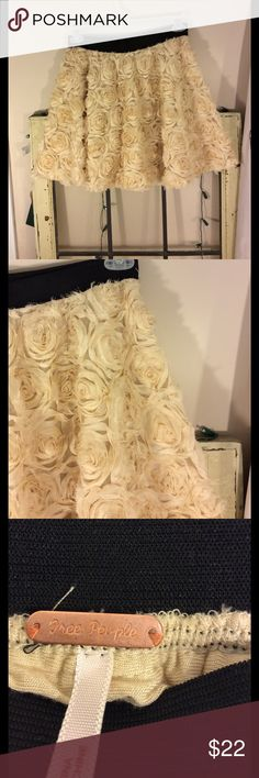 Free people romantic rose petal design skirt Super cute and feminine rose petal design free people skirt Size medium Length from top to bottom is 17 inches Waist  is 14 inches expands up to 18 inches Good condition Creamy peach color Free People Skirts Mini