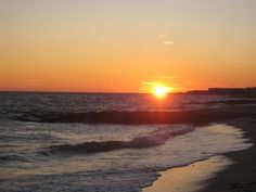 Gorgeous sunset over the ocean in West Harwich, MA (Not my photo) Memories of a lifetime.. bringing.Margarita pizza and wine to the beach...