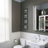 An inexpensive alternative to tile, beadboard is a great choice for bathrooms because it is relatively durable, can be painted any color, and can be installed at any height. While you often see it in traditional or rustic bathrooms, bead board does not have to impart a cutesy country feel. It can be positively sleek and cool. And best of all, beadboard can add a new visual contrast to any remotely blah bathroom.