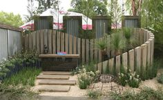 Achievable Gardens at MIFGS 2013 GardenDrum 'Coastal Wave' Design Rohan Thorn Holmesglen TAFE What a beautiful double wall, with waves of bleached grey timber creating great space-stretching layering. It was hard to believe that this garden was exactly Seaside Garden, Coastal Gardens, Fence Landscaping, Backyard Fences, Backyard Ideas, Australian Native Garden, Australian Garden Design, Garden Screening, Garden Show