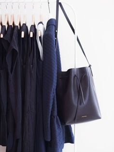 How to Dress Like a French Woman-Less is more No saying could be truer when it comes to Parisian dressing. Focus on interesting shapes and textures (preferably in muted colors) and you'll be fine—a stop at COS and & Other Stories is a must if you want to pick up a few tips about young and cool Parisian dressing. Stay away from too many embellishments and short dresses—basically anything that can be perceived as tacky.