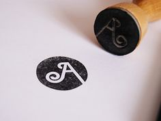 Circle stamp with letter - full bleed