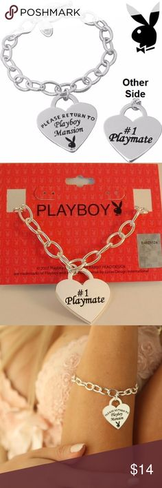 "Tiffany Style Playboy Bracelet Heart Charm Toggle Tiffany style Playboy Heart charm toggle bracelet. Silver plated. Heart tag charm says ""#1 Playmate"" on one side and Reverses to ""PLEASE RETURN TO Playboy Mansion"" along with the Iconic Playboy Bunny logo symbol. Includes Playboy hanging retail card with hologram sticker which proves authenticity. Genuine Authentic Officially Licensed Playboy Jewelry MPN: CPBB2631 Bracelet Measures 7.25 inches long X over 1/4 inch wide link chain Heart Charm…"