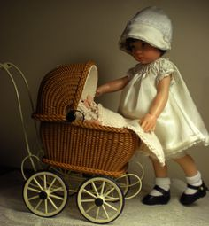 A 2010 collaboration of four artists, from Canada and USA (California, Maryland, and Nebraska) created a doll vignette as a tribute to Christine's Mother, Dot, a child of the 1920s.  Marie Terrones of Wickerville made the buggy.  Cecilia, Chiditta, the seamstress, succeeded with brilliance.  Nancy Lee Moran repainted the Kish doll.  See more photos and read the story by clicking on the image.