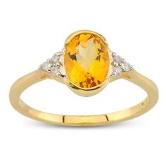 Solitaire Oval Cut Tension And Prong Set Citrine Diamond Gemstone Ring In 14K Yellow Gold    $284.00