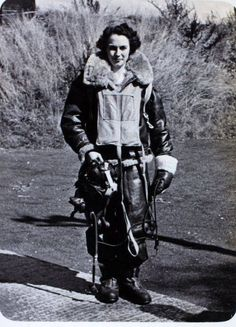 Mary a pilot of the Air Transport Auxiliary in her gear to fly her Spitfire c. 1944