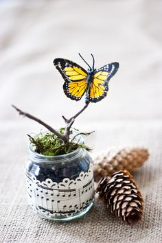 butterflies - with baby food jars, sheet music, moss, and ribbons - such a cute way to decorate for spring! #Butterfly #Crafts #Spring - pb†å