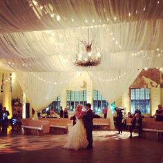 Bride and groom first dance under their fairytale tent.  Draping & lighting by @Innovative Event Solutions, rentals by Marianne's and Mood. #wedding