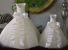 15 inch high wedding table centerpiece. Top is hollow made using craft porcelain compound. Ivory tulle skirt sits on a heavy paper cone. Ivory