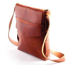 Hit the streets in style with this classy explorer shoulder bag! The item measures 10 x 13 x 2 and features an exterior pocket and flap closure. Available in five leather tones, including black, buckskin, burgundy, dark brown and saddle. Perfect for special engagements or unique custom needs for corporate events. Made in USA. Leave the ordinary and mundane at home and go about your day with this beautifully-crafted leather sling tote!