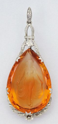 Citrine Cameo and 14K White Gold Pendant, circa 1930 height 2 1/8 ins, 7/8 in, maker's mark