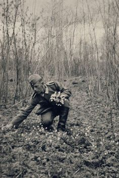Soldier picking flowers in honor to the victims of the PCW or Pacific Civil War.