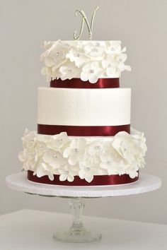 Without flowers, simple and nice with the cranberry colored ribbon