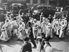 A British parade of female munition workers during a 'patriot procession' on 23 July 1916