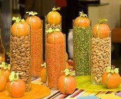 Candle motifs filled with dried beans and then topped with pumpkins