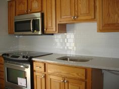 Add Kitchens Beauty with Subway Patterned Tiles Backsplash below Mounting Cabinet: mesmerizing wooden kitchen cabinets with brown granite countertop also white subway tile backsplash – Cooqy.com