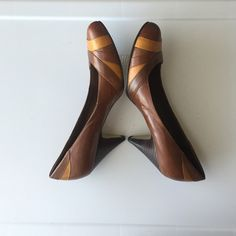 Nine West brown pumps Brown with mustard yellow accents round toe pumps from Nine West. Good condition. Heel height is 2 inches. Nine West Shoes Heels
