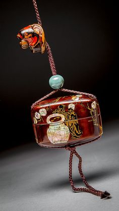 JAPANESE MOTHER OF PEARL INLAID LACQUER INRO, 19TH CENTURY With a jade stopper and carved lacquer netsuke. Dimensions: Height 2 1/2 in. (6.4 cm.)