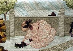 """#16 """"New Bonnet Girl Cousins""""  Carmella $13.50.  Carmella is walking in the fenced stone garden. Flowers and trees are appliquéd on to a shadow appliqué sky and ground."""