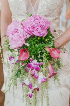 pink peonies, dendrobiums, and mini calla lilies, photo by Dixie Pixel Photography http://ruffledblog.com/virginia-boathouse-wedding #weddingbouquet #bouquets #flowers