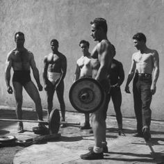 Prisoners at San Quentin Weightlifting in Prison Yard During Recreation Period Photographic Print by Charles E. Steinheimer - AllPosters.co....