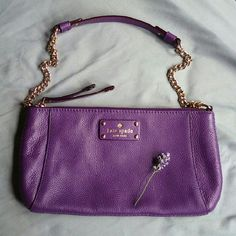 Lowest•Kate Spade Purse Kate Spade shoulder bag in beautiful purple color, black and white polka dot lining. Hardly worn, EUC, just got a few months ago, unfortunately I am more of a crossbody kind of girl. Small mark on bottom shown in third picture. No trades please. kate spade Bags Shoulder Bags
