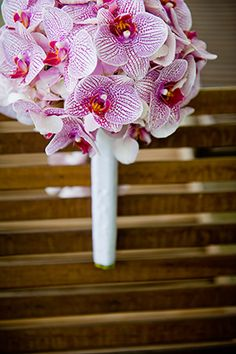 Orchid bouquet for a tropical destination wedding. // Photo by http://oliviavale.com
