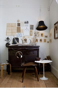 So many great things in this photo. Loved the found art, the big antler, and the mix of a modern white table