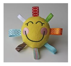 Baby toy    Supplies:  Scissors,1 foot of fabric/person, Ribbon, Sewing needles, Thread, Cotton balls