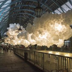 Artist Charles Pétillon suspends 100000 white balloons inside London's Covent Garden market in anticipation of the upcoming London Design Festival. by hypebeast