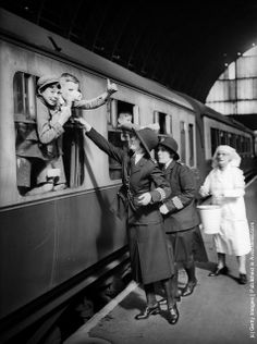 Two policewomen and a VAD (Voluntary Aid Detachment) nurse serve refreshments to the young evacuees before their departure from London to the comparative safety of the countryside during World War II. (Photo by A. J. O'Brien/Fox Photos/Getty Images). 18th June 1940