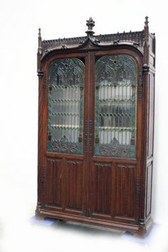 Gothic cabinet circa late 19th century. Very rare piece to have the leaded stained glass doors. www.thegatz.com