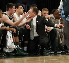 Michigan State head coach Tom Izzo talks to Matt Costell on the bench after he came out of the game in the first half against Virginia.