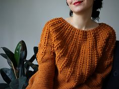 Stunning rows of puff stitches flow down and give a royal feel to the Goldenrod Sweater.