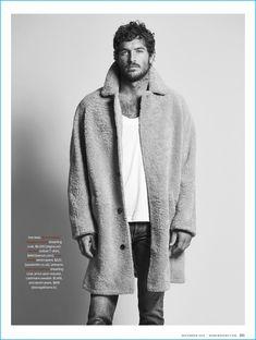 Model Justice Joslin sports an Ermenegildo Zegna Couture shearling coat, Berluti t-shirt, and Paul Smith denim jeans.