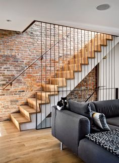 Brooklyn Home with Brick Walls Gets a Modern Renovation i like the brick wall. But we want open staircases. Brick Interior, Interior Stairs, Interior And Exterior, Interior Design, Design Interiors, Interior Modern, Modern Luxury, Modern Staircase, Staircase Design