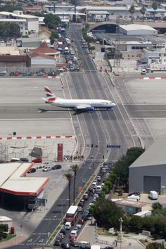 Gibraltar Airport, Gibraltar, British Territory The runway crosses a highway as the stopped cars attest. Gibraltar airport serves both military and passenger traffic and is located close to the famous Rock of Gibraltar. Rock Of Gibraltar, Places To Travel, Places To Visit, British Overseas Territories, Air Travel, International Airport, International Airlines, Malaga, Landing