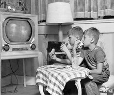 Eating in front of the television set became a way of life for many Americans in the 1950's.   These children eat and watch on June 28, 1951.