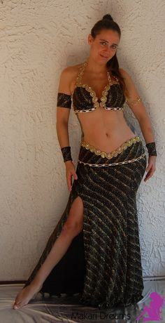 http://www.makaridreams.com/ Very exclusive and elegant belly dance costume. Made with fancy black-gold glitter lycra and decorated with gold tone rhinestones.  280 €  By Atelier Makari Dreams Belly Dance Costumes.  Order online: http://www.makaridreams.com/