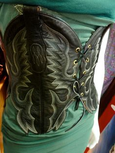 Upcycled boot into a waist clincher. Holy mother of pearl. THIS IS SUCH A COOL DESIGN.
